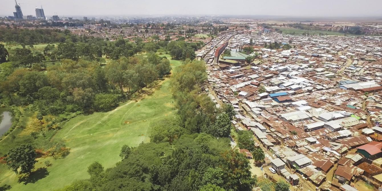The chaos, noise, and density of the slum is neatly juxtaposed with the orderly calm green of the Royal Nairobi Golf Club, which opened in 1906. Unequal Scenes - by Johnny Miller